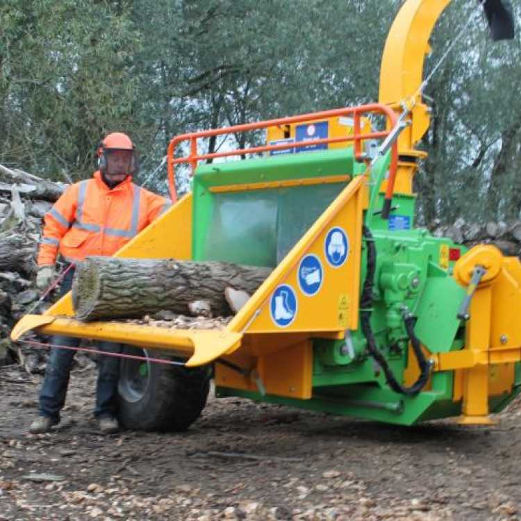 Heizohack 8-400 Chipper being used by an experienced member wearing a high-viz jacket, safety helmet and gloves on a winters day in Colchester
