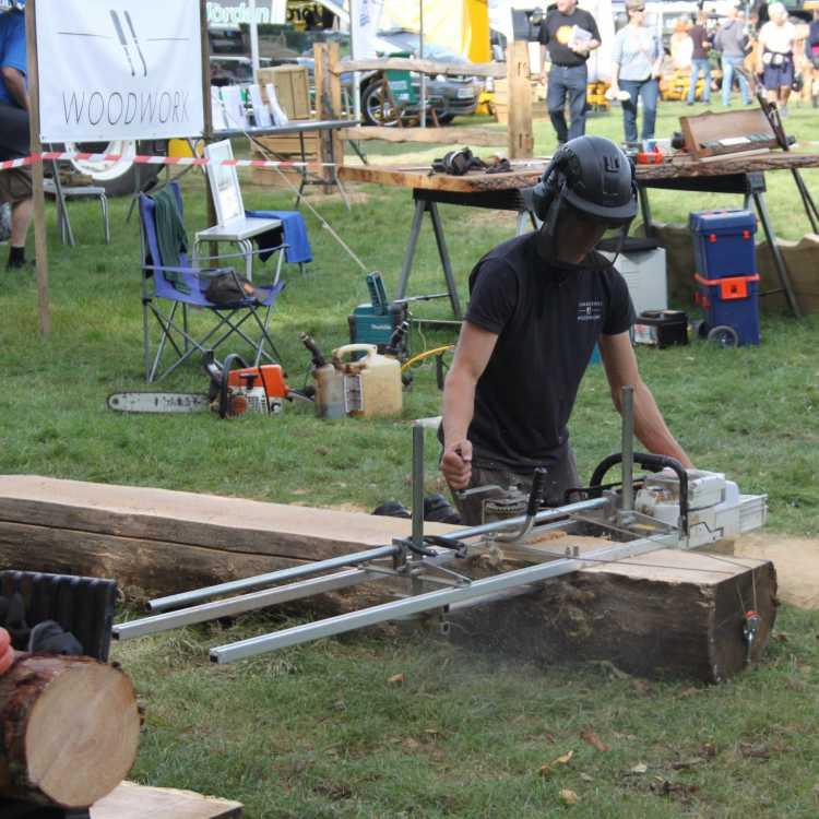 James demonstrating his Alaskan saw mill (Summerhill Woodwork)