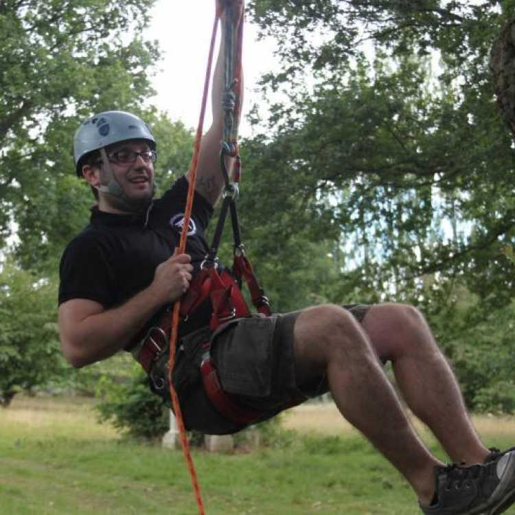 Man starting his tree climbing experience