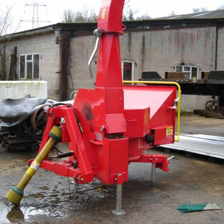 A Red Linkage Mounted Chipper sitting outside a facility in Sussex on a winters day