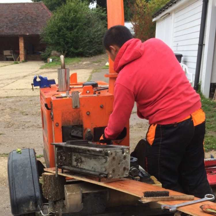 An experienced member of the Scott Fraser Training team removing the rollerbox from a Red Timberwolf Chipper