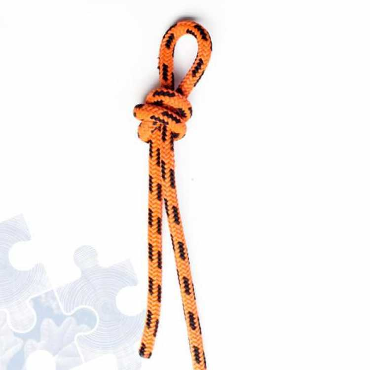 Orange rope showing third step of creating a Fishermans knot