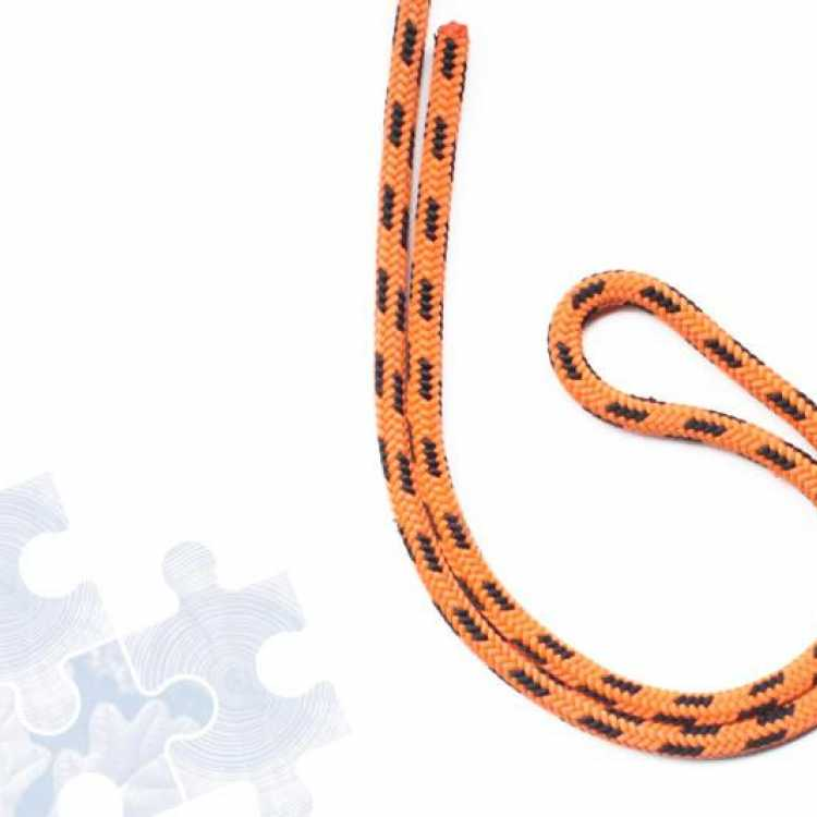 Orange rope showing first step of creating a Double figure of Eight knot