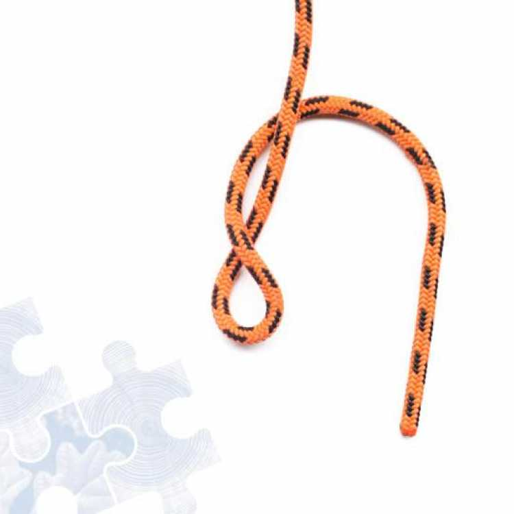 Third step on how to tie a Figure of 8 Knot