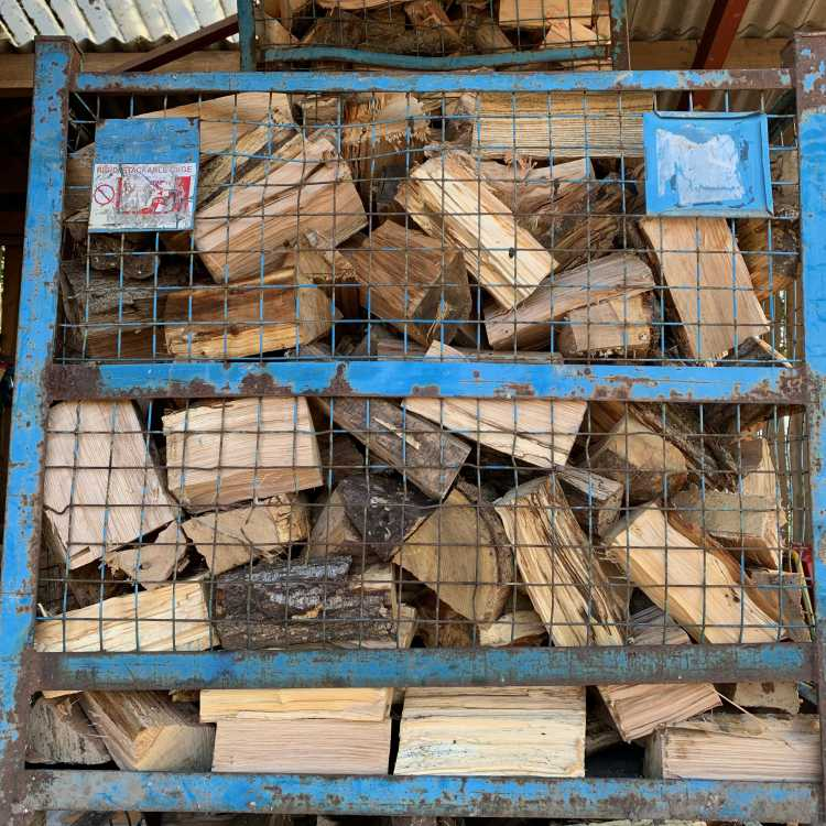 firewood stored in crates to maximise drying