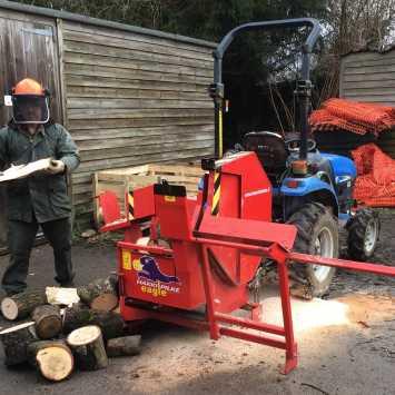 Man using a Firewood Processor